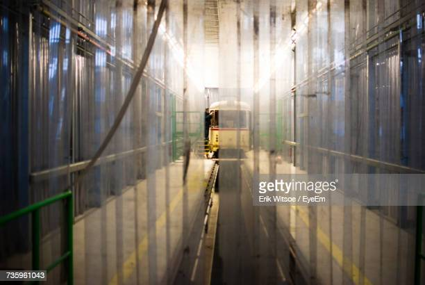 Mid Distance View Of Man Repairing Train