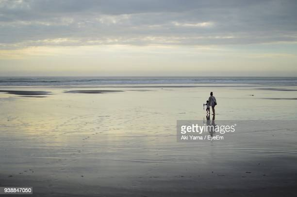 Mid Distance View Of Mother And Son Playing At Beach