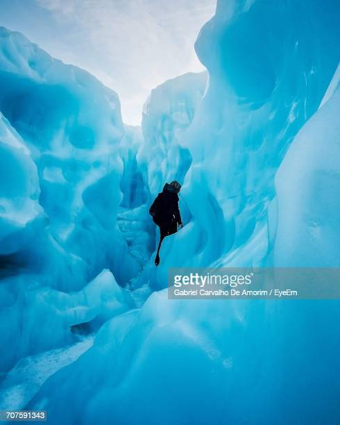 Mid Distance View Of Person Amidst Fox Glacier During Winter