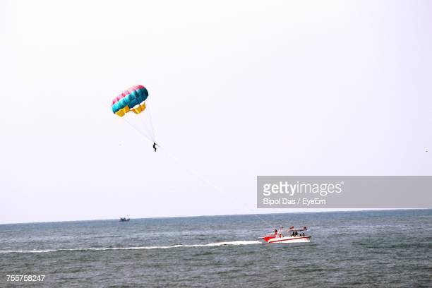 Mid Distance View Of Person Parasailing Over Sea Against Sky
