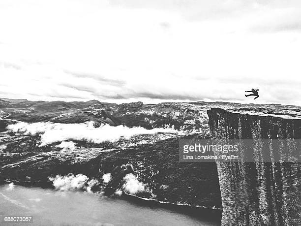 Mid Distance View Of Person Performing Stunt On Preikestolen Cliff
