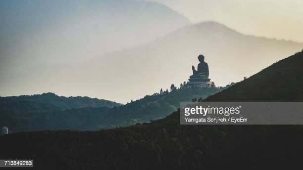Mid Distance View Of Tian Tan Buddha Monument On Mountain During Foggy Weather