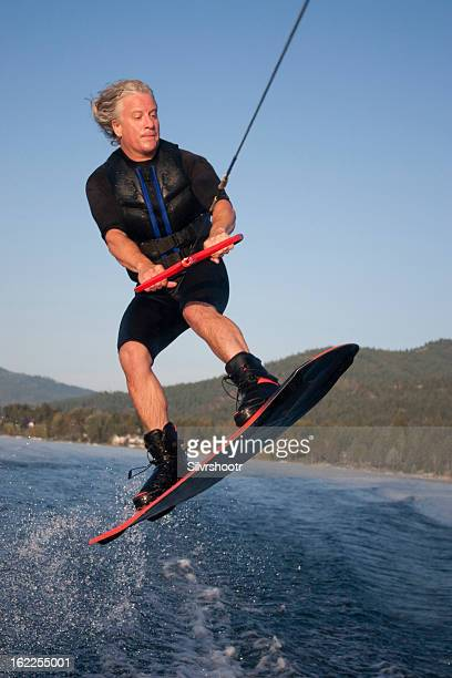 Mid forties male jumping on his wakeboard