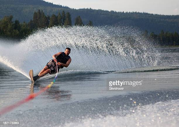 mid forties male waterskiing - waterskiing stock photos and pictures