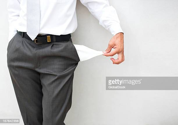 Mid section of a businessman showing empty pocket