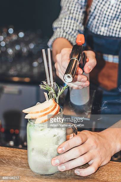 Mid Section Of A Man Preparing Cocktail