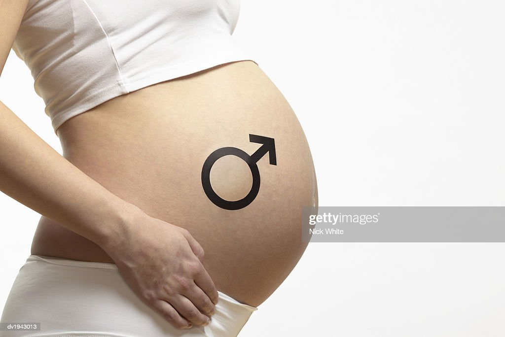 Mid section of a Pregnant Woman With a Male Symbol on Her Stomach : Stock Photo