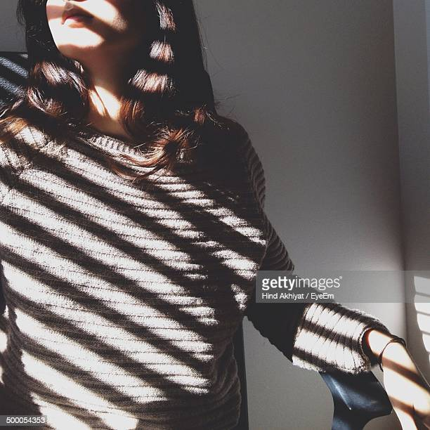 Mid section of a sunlight on woman