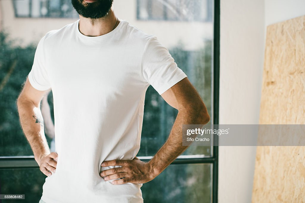 Mid section of bearded man wearing t-shirt : Foto stock