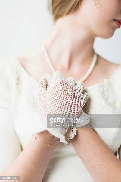 Mid section of bride wearing formal glove