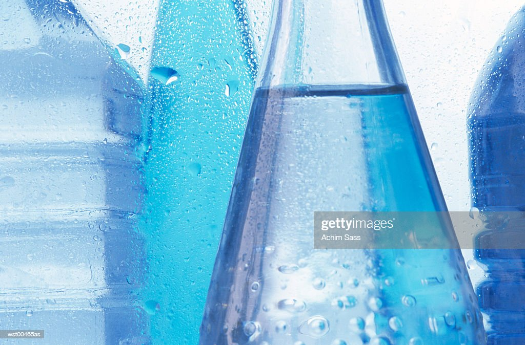 Mid section of cold bottled water, close up : Stock Photo