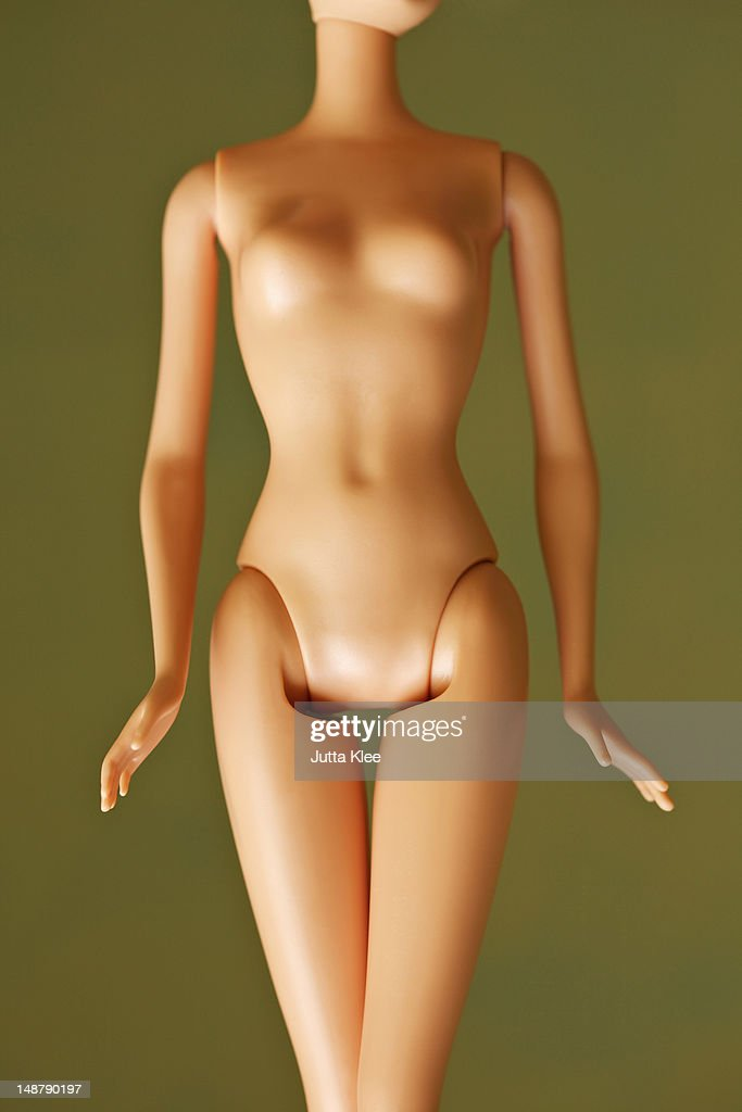 mid section of fashion doll body : Stock Photo