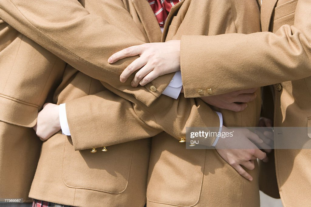 Mid Section of High School Students Hugging Each Other : Photo