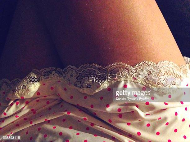 mid section of woman in night dress - women in slips stock photos and pictures