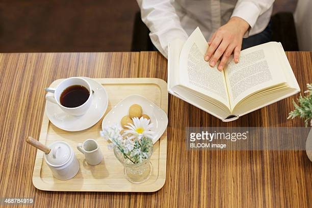 Mid section of woman relaxing in cafe