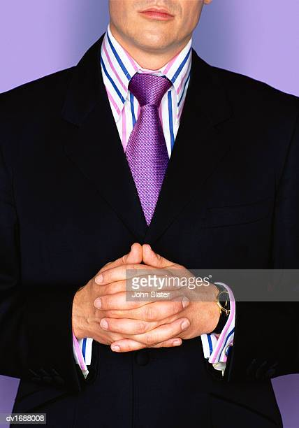 mid section portrait of a well dressed businessman with his hands together - purple suit stock pictures, royalty-free photos & images