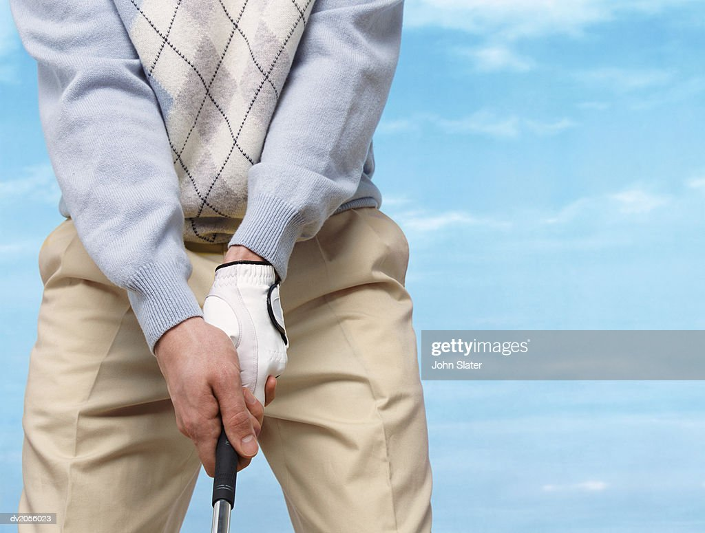 Mid Section Shot of a Golfer Gripping a Golf Club : Stock Photo