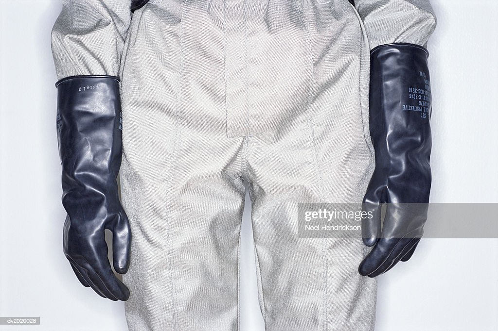 Mid Section Studio Shot of a Person Wearing a Protective Suit and Gloves : Stock Photo