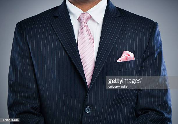 Mid section view of a businessman