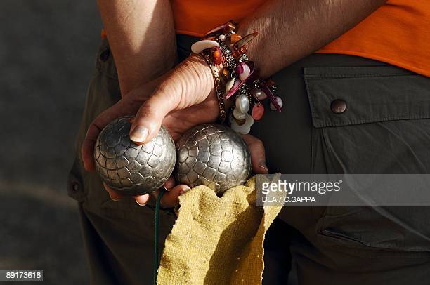 Mid section view of a man holding boules AlpesMaritimes France