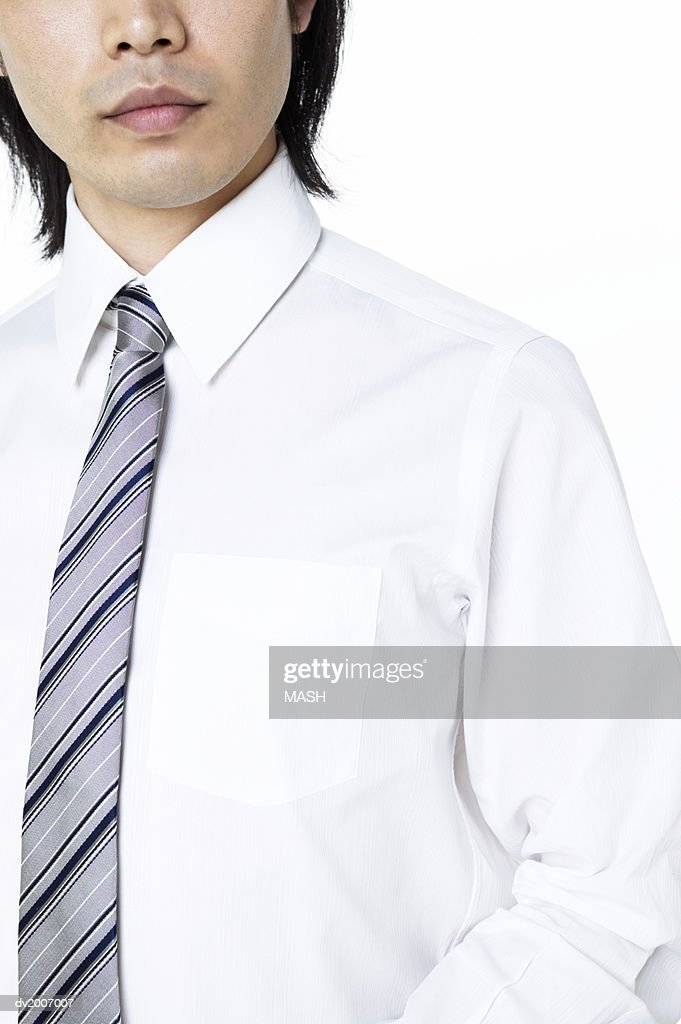 Mid Section View of a Man Wearing a Shirt and Tie : Stock Photo