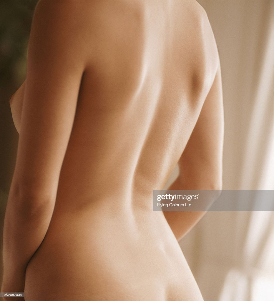 Mid Section View of a  Naked Woman's Back : Stock Photo