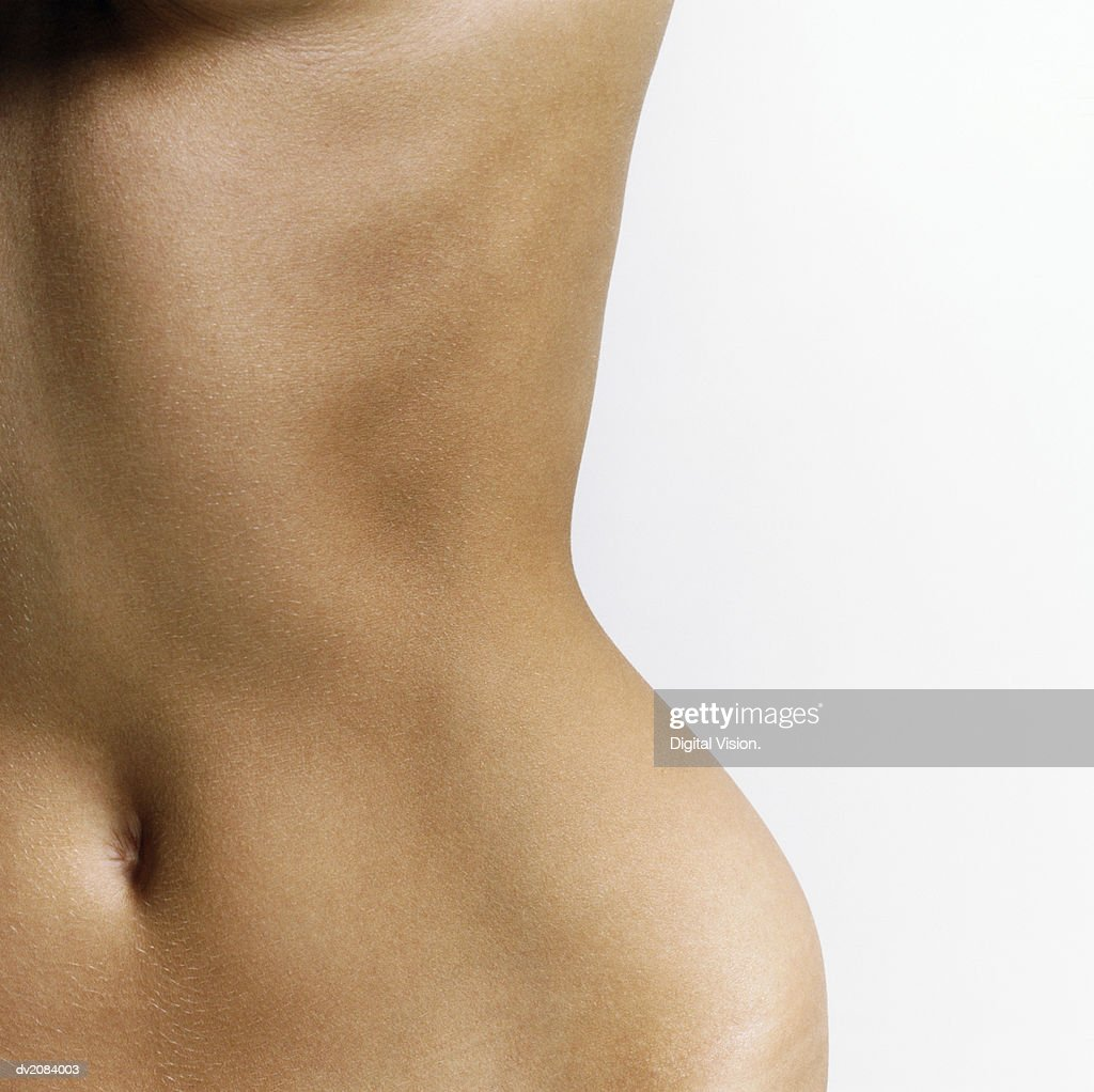 Mid Section View of a Naked Woman's Stomach : Stock Photo