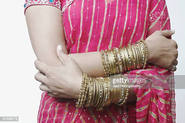 Mid section view of a woman wearing bangles