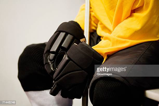 mid section view of an ice hockey player in a uniform - ice hockey glove stock pictures, royalty-free photos & images