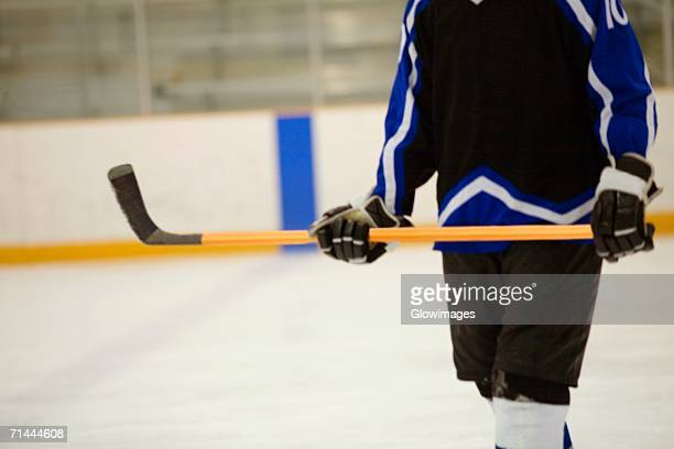 mid section view of an ice hockey player - ice hockey uniform stock pictures, royalty-free photos & images