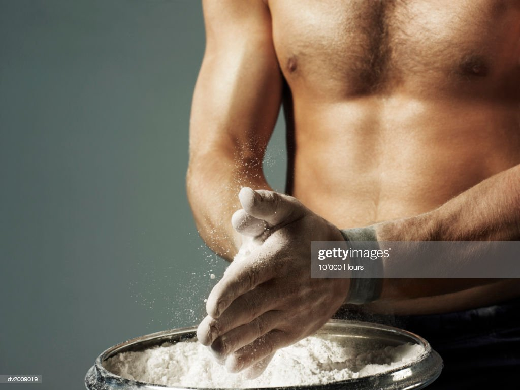 Mid Section View of Male Athlete Applying Chalk to His Hands : Stock Photo