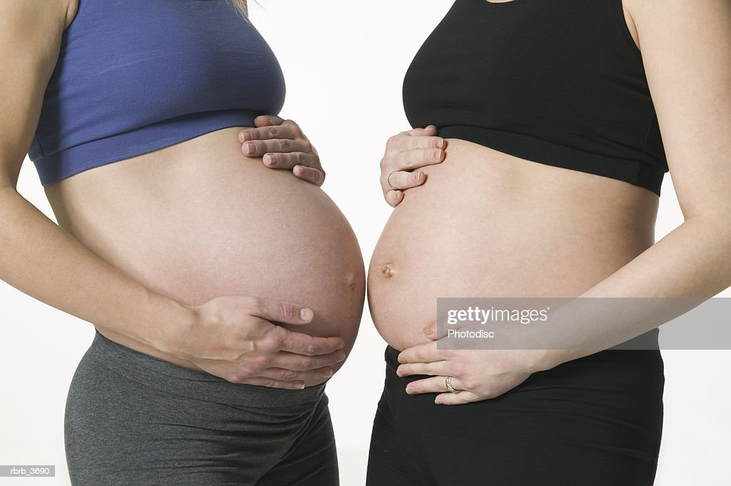 Mid section view of two pregnant young women : Stockfoto