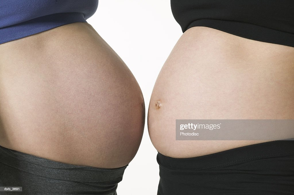 Mid section view of two pregnant young women : Foto de stock