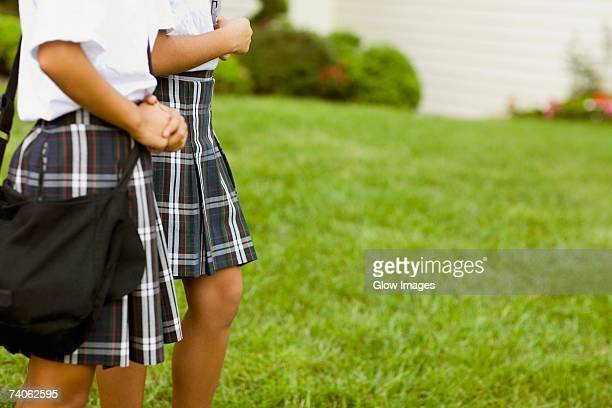 mid section view of two schoolgirls walking - up skirts stock pictures, royalty-free photos & images