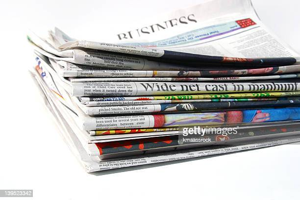 A mid size stack of Arvada newspapers