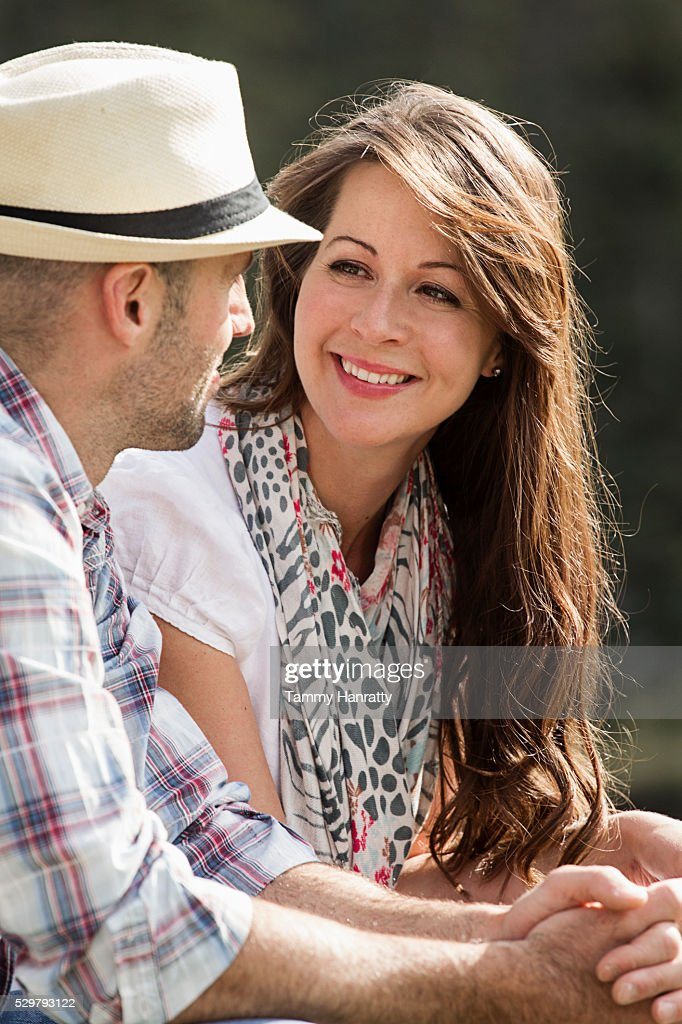 Mid-adult couple relaxing outdoors : Stock Photo