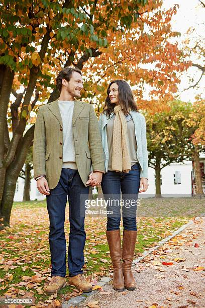 Mid-adult couple standing in park