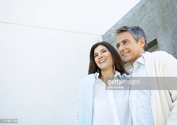Mid-adult couple wearing button down shirts