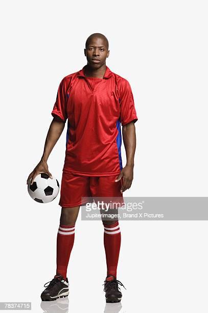 Mid-adult man palming soccer ball