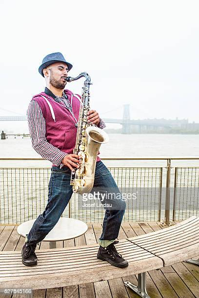 Mid-adult man playing saxophone
