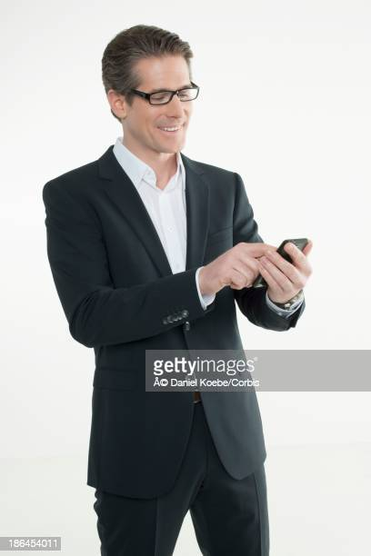 Mid-adult man using cell phone