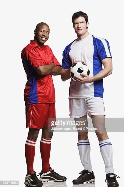 mid-adult men with soccer ball - tenue de football photos et images de collection