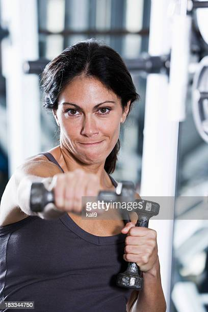 mid-adult woman at the gym - mid adult stock pictures, royalty-free photos & images