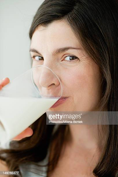 Mid-adult woman drinking glass of milk
