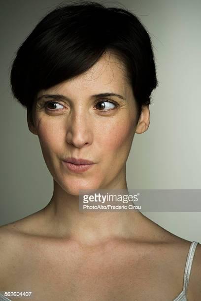 Mid-adult woman glancing sideways, portrait