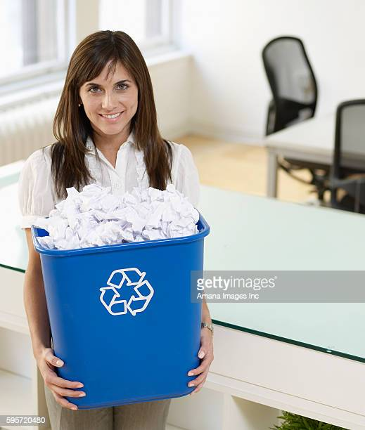 Mid-Adult Woman Holding Paper Recycling Bin