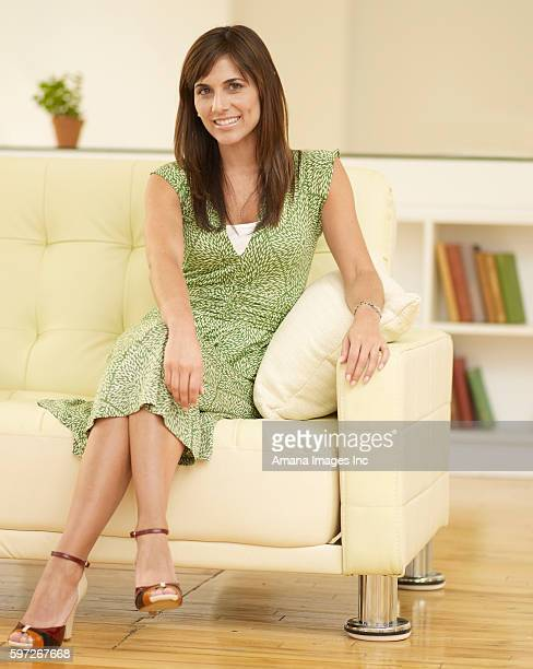 Mid-Adult Woman Sitting on Sofa
