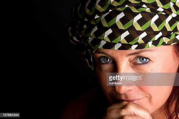 mid-adult woman smiling - muslim woman darkness stock photos and pictures