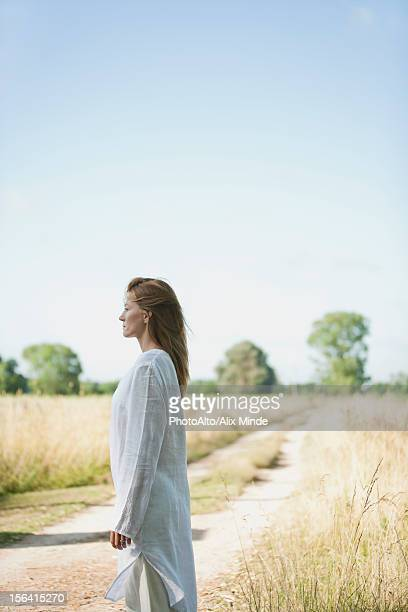 Mid-adult woman standing in field