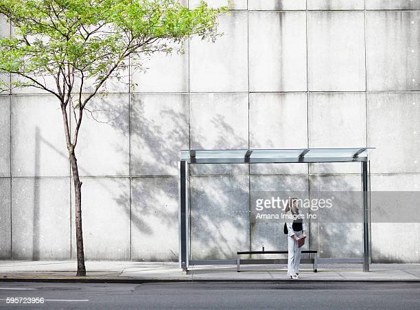Mid-Adult Woman Waiting at Bus Stop